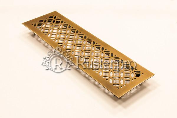 Вентиляционная решетка в подоконник из латуни с эффектом затертости