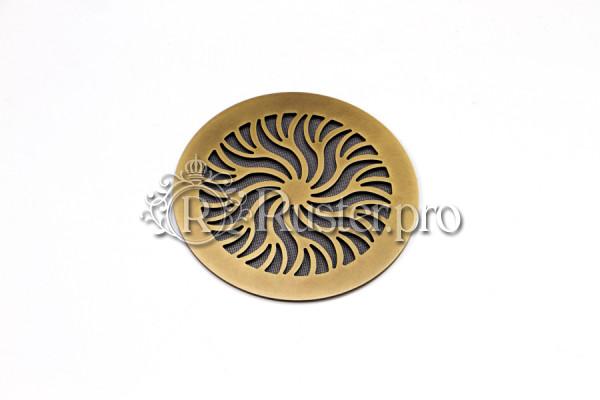 Круглая вентиляционная решетка из состаренной латуни с орнаментом Лучи солнца